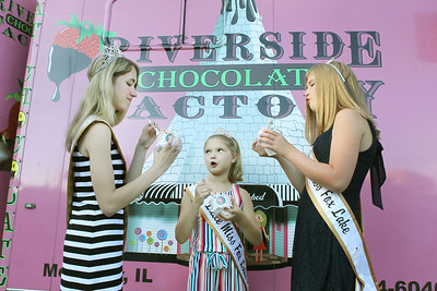 Candace H. Johnson-For Shaw Media Alyia Thibault, 17, Maddie McCart, 9, and Aleah Inman, 12, all Fox Lake 2019 queens, eat some ice cream from the Riverside Chocolate Factory at the Fox Lake Farmers Market on School Court in Fox Lake. The market runs on Tuesday nights from 4 -8:00 pm. through September. (8/20/19)