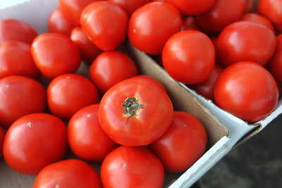Candace H. Johnson-For Shaw Media Bright red Elite tomatoes were for sale from the Six Generations Farm, of Troy during the Fox Lake Farmers Market on School Court in Fox Lake. The market runs on Tuesday nights from 4 -8:00 pm. through September. (8/20/19)