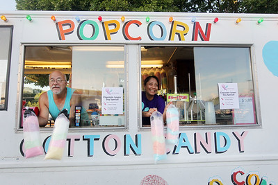 Candace H. Johnson-For Shaw Media Bob and Maria Colson, of Wauconda with Kiki's Cotton Candy sell cotton candy from their food truck at the Fox Lake Farmers Market on School Court in Fox Lake. The market runs on Tuesday nights from 4 -8:00 pm. through September. (8/20/19)