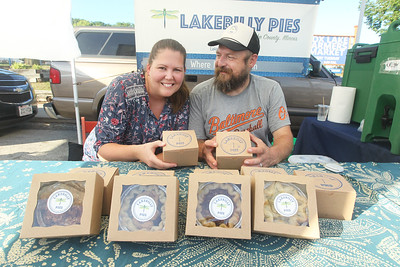 Candace H. Johnson-For Shaw Media Heather and Tom Truffer, of Mundelein with Lakebilly Pies show off their pies for sale at the Fox Lake Farmers Market on School Court in Fox Lake. The market runs on Tuesday nights from 4 -8:00 pm. through September. (8/20/19)