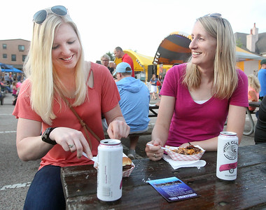 Candace H. Johnson-For Shaw Media Jessica Centa and Erin Newsom, both of Grayslake enjoy some food from BBQ'd Productions during Grayslake Summer Days in downtown Grayslake. (8/17/19)