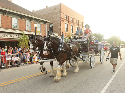 Candace H. Johnson-For Shaw Media The Renegade Clydesdales make their way down Center Street during the Grayslake Summer Days Parade in downtown Grayslake. (8/17/19)