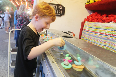 Candace H. Johnson-For Shaw Media Paul L., 5, of Grayslake plays the Duck Game to win a prize during Grayslake Summer Days in downtown Grayslake. (8/17/19)