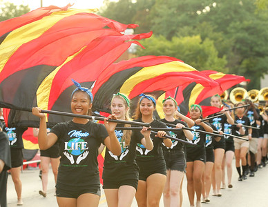 Candace H. Johnson-For Shaw Media Grayslake Central's Jennica Sajor waves her flag with the Color Guard as they make their way down Center Street during the Grayslake Summer Days Parade in downtown Grayslake. (8/17/19)