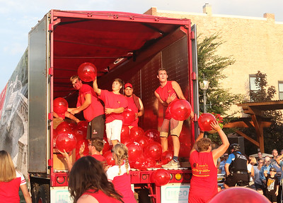 Candace H. Johnson-For Shaw Media Lester's Material Service ball handlers throw out bright red balls to the crowd during the Grayslake Summer Days Parade on Center Street in Grayslake. (8/17/19)