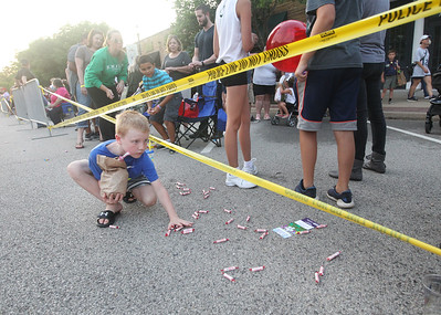 Candace H. Johnson-For Shaw Media Everett Kent, 8, of Grayslake picks up candy after the Grayslake Summer Days Parade on Center Street in Grayslake. (8/17/19)