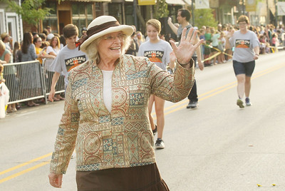 Candace H. Johnson-For Shaw Media Joyce Norton, of Grayslake waves to the crowd as she walks with others from the Grayslake Heritage Center & Museum during the Grayslake Summer Days Parade on Center Street in downtown Grayslake. (8/17/19)