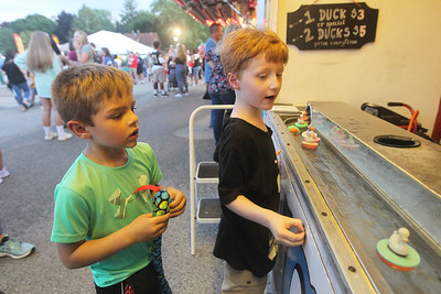 Candace H. Johnson-For Shaw Media Nathan M., 6, of Algonquin watches his friend, Paul L., 5, of Grayslake play the Duck Game during Grayslake Summer Days in downtown Grayslake. (8/17/19)