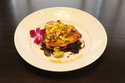 Candace H. Johnson-For Shaw Media Grilled swordfish with mango salsa, black forbidden rice, roasted red peppers and brussel sprouts is featured at Primo Italian American Cuisine in Gurnee. Primo Italian American Cuisine is part of Khayat Enterprises, where Nicole Khayat is president and co-owner. (8/19/19)