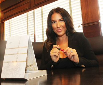 Candace H. Johnson-For Shaw Media Nicole Khayat, co-owner of Khayat Enterprises and president of Fancy Face Cosmetics, holds one of the lipsticks featured in her Fancy Face Cosmetics Volume 3 makeup palette at her restaurant, Primo Italian American Cuisine in Gurnee. (8/19/19)