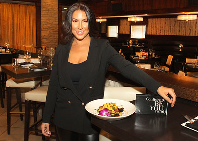 Candace H. Johnson-For Shaw Media Nicole Khayat, co-owner of Khayat Enterprises and president of Fancy Face Cosmetics, at her restaurant, Primo Italian American Cuisine in Gurnee. (8/19/19)