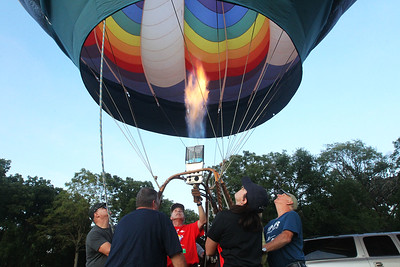 Candace H. Johnson-For Shaw Media Alan Zielinski, of Niles, (center) pilot and owner of the Featherlight II hot air balloon works with his crew to keep the envelope of the balloon standing tall during the Color Aloft Balloon Festival at Central Park in Grayslake. (8/24/19)