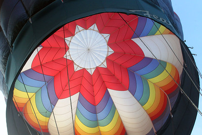 Candace H. Johnson-For Shaw Media The colors inside of the Featherlight II hot air balloon envelope owned by Alan Zielinski, of Niles shine brite during the Color Aloft Balloon Festival at Central Park in Grayslake. (8/24/19)