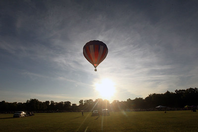 Candace H. Johnson-For Shaw Media The Cloud Dancer hot air balloon piloted by Bill Buchar, of Shorewood flies high during the Color Aloft Balloon Festival at Central Park in Grayslake. (8/24/19)
