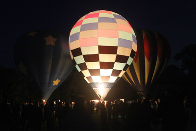 Candace H. Johnson-For Shaw Media Kim Neill's, of Riverwoods, Traveller hot air balloon lights up at night during the Color Aloft Balloon Festival at Central Park in Grayslake. (8/24/19)