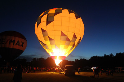 Candace H. Johnson-For Shaw Media The Kay's WindDancer II hot air balloon owned by Ken Walter, of Waukesha, Wis., lights up the night sky standing over 75 ft. tall during the Color Aloft Balloon Festival at Central Park in Grayslake. (8/24/19)