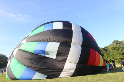 "Candace H. Johnson-For Shaw Media Don Raciborski, of Harvard and his crew inflate their ""Sams Deal"" hot air balloon during the Color Aloft Balloon Festival at Central Park in Grayslake. (8/24/19)"