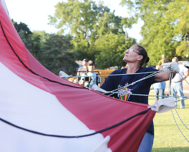 Candace H. Johnson-For Shaw Media Denise Rucker, of Geneva City helps to launch the Cloud Dancer hot air balloon during the Color Aloft Balloon Festival at Central Park in Grayslake. The hot air balloon was owned by Bill Buchar, of Shorewood. (8/24/19)