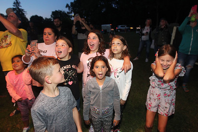 Candace H. Johnson-For Shaw Media A group of children react when a propane heater is turned on to warm the Featherlight II hot air balloon's envelope during the Color Aloft Balloon Festival at Central Park in Grayslake. Alan Zielinski, of Niles owner and pilot of the Featherlight II hot air balloon turned on the heater. (8/24/19)