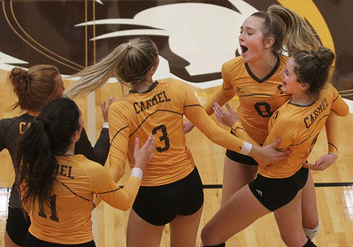 Candace H. Johnson-For Shaw Media Carmel's varsity girls volleyball team celebrates a point against Warren in the first set during the season opener at Carmel Catholic High School in Mundelein. Carmel won 25-12, 25-12. (8/26/19)
