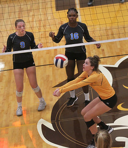 Candace H. Johnson-For Shaw Media Carmel's Molly Halverson returns the ball against Warren's Samantha Aaron and Faith Pollard in the first set during the season opener at Carmel Catholic High School in Mundelein. Carmel won 25-12, 25-12. (8/26/19)