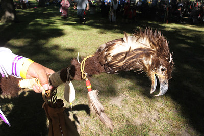 Candace H. Johnson-For Shaw Media Arlyn Cornelius, of Gillett, Wis., shows an Eagle head stick used in Native American dancing during the 26th Annual Potowatomi Trails Pow Wow at Shiloh Park in Zion. (8/24/19)