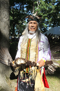 Candace H. Johnson-For Shaw Media Arlyn Cornelius, of Gillett, Wis., stands tall wearing his Native American regalia during the 26th Annual Potowatomi Trails Pow Wow at Shiloh Park in Zion. (8/24/19)