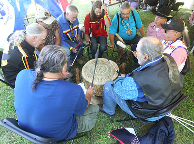 Candace H. Johnson-For Shaw Media A group of men perform intertribal drumming to celebrate Native American heritage and culture during the 26th Annual Potowatomi Trails Pow Wow at Shiloh Park in Zion. (8/24/19)