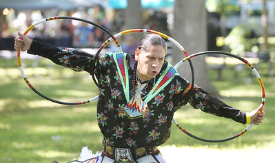 Candace H. Johnson-For Shaw Media Ronnie Preston, of St. Francis, Wis., performs a hoop dance during the 26th Annual Potowatomi Trails Pow Wow at Shiloh Park in Zion. (8/24/19)