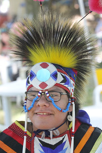 Candace H. Johnson-For Shaw Media Winfield Wounded Eye, 16, of Chicago from the Northern Cheyenne tribe wears a porcupine head roach during the 26th Annual Potowatomi Trails Pow Wow at Shiloh Park in Zion. (8/24/19)