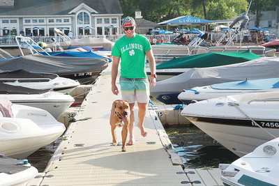 Candace H. Johnson-For Shaw Media Scott Vasicek, of Wauconda walks with his dog, Forest, on the pier after docking his boat at Lindy's Landing Marina in Wauconda. (8/16/20)