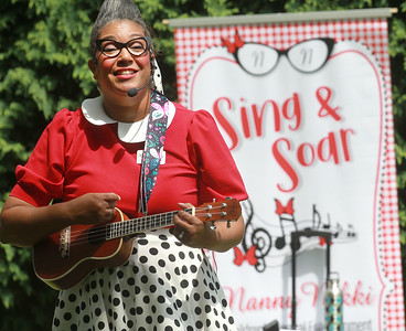 Candace H. Johnson-For Shaw Media Nanny Nikki (Nikki Rung, of Fox Lake) sings classic children's songs at a birthday party for Lily Bajek, who just turned 3, at the Bajek's home in Lake Villa. Nanny Nikki has her own YouTube channel. (8/5/20)