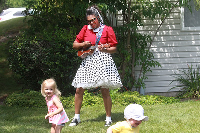 Candace H. Johnson-For Shaw Media Nanny Nikki (Nikki Rung, of Fox Lake) sings classic children's songs for a birthday party for Lily Bajek, who just turned, 3, (on left,) as she dances at a distance with Henry Jones, sixteen-months-old, of Tinley Park at the Bajek's home in Lake Villa. (8/5/20)