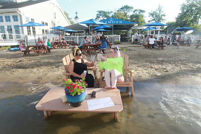 Candace H. Johnson-For Shaw Media Lisa Ksandr, of Lake Zurich and Hailey Iwanicki, of Volo enjoy drinks on the beach at Lindy's Landing in Wauconda. Lisa Ksandr was celebrating her recent engagement to Mike Beauvais.(8/16/20)