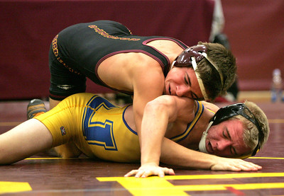 Monica Maschak - mmaschak@shawmedia.com Richmond-Burton's Grant Sutton pins Johnsburg's Branden Peshek to the mat in the 120 weight class championship match at the Richmond-Burton wrestling tournament on Saturday, December 1, 2012.  Sutton won the match 2-0.