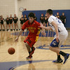 Nathan Tague drives towards the basket during Batavia's game against Geneva on Friday, Nov. 30.<br /> Staff photo by Sarah Minor