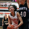 Jeff Krage -- For the Kane County Chronicle<br /> St. Charles East's Kyra Washington looks for a shot around St. Charles North's Morgan Rosencrants during Saturday's game at St. Charles East High School.<br /> St. Charles 12/1/12