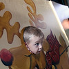 Jeff Krage -- For the Kane County Chronicle<br /> Ethan Walter (left), 3, of Sugar Grove gets his picture taken Saturday as his brother Andrew, 6, peers out another opening during Holiday in the Grove at the Sugar Grove Community House.<br /> Sugar Grove 12/1/12