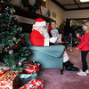 Jeff Krage -- For the Kane County Chronicle<br /> Tyler Plank, 6, of Montgomery and his sister Abby, 4, greet Santa Claus with their Christmas wish list during Saturday's Holiday in the Grove at the Sugar Grove Community House.<br /> Sugar Grove 12/1/12