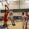 Geneva's Luke Polishak knocks a rebound out of the hands of Batavia's Miek Rueffer.<br /> Staff photo by Sarah Minor