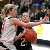 Jeff Krage -- For the Kane County Chronicle<br /> St. Charles North's Alex Silverman is fouled by St. Charles East's Hannah Nowling on her way to the basket during Saturday's game at St. Charles East High School.<br /> St. Charles 12/1/12