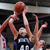 Jeff Krage -- For the Kane County Chronicle<br /> St. Charles North's Morgan Rosencrants has her shot blocked by St. Charles East defenders during Saturday's game at St. Charles East High School.<br /> St. Charles 12/1/12