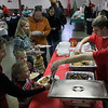 Jeff Krage -- For the Kane County Chronicle<br /> Families are served sausage and pancakes during Saturday's breakfast with Santa at the Sugar Grove Community House.<br /> Sugar Grove 12/1/12