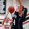Jeff Krage -- For the Kane County Chronicle<br /> St. Charles East's Katie Claussner has her shot blocked by St. Charles North's Liz McNally during Saturday's game at St. Charles East High School.<br /> St. Charles 12/1/12