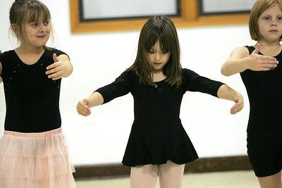Monica Maschak - mmaschak@shawmedia.com Ava Raske (center), 6, and her classmates practice basic ballet steps in the weekly Ballet and Tap II class at the McHenry Municipal Building on Thursday, December 6, 2012.  A study from Vanderbilt University found that when children have active friends that they tend to be more active as well.