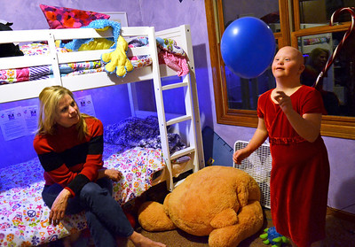 Monica Maschak - mmaschak@shawmedia.com Mallory Taylor (right) plays with a balloon in her Spring Grove bedroom as her mother, Susan, watches.  Taylor will be turning 12 on December 12, 2012, the last repetitive date for another century, and her family will be throwing a big party for her at a local restaurant.