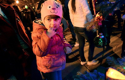 Monica Maschak - mmaschak@shawmedia.com Madison Seich, 3, admired the 20-foot Christmas tree at the Holiday Rock on The Fox in Algonquin on Saturday, December 1, 2012. The tree was lit by Santa and four community helpers this year.