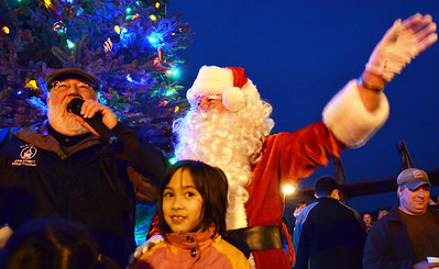 Monica Maschak - mmaschak@shawmedia.com Algonquin Village President John Schmidt lit the 20-foot Christmas tree with Santa and four little helpers at the Holiday Rock on The Fox in Algonquin on Saturday, December 1, 2012.
