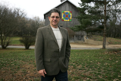 Monica Maschak - mmaschak@shawmedia.com Newly-elected Democratic County Board member Nick Chirikos stands in front of a barn, built in 1895, on his Algonquin property. Chirikos is a history buff and motorcycle enthusiast.