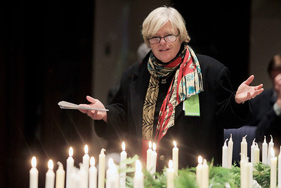Sarah Nader - snader@shawmedia.com Chaplain at Centegra Health Systems Dorothy Symonds, says a prayer during Centegra Health System's annual candlelight memorial service at the Church of the Holy Apostles in McHenry on Monday, December 10, 2012. Children who have died from conception shortly after live birth were memorialized during the service that was designed for people of all faiths.